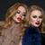 two beautiful girls in fashion fur coats stock photo © svetography