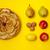 Whole tarte Tatin apple tart with fruits on yellow background stock photo © szabiphotography