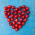 heart shaped cherries on blue background cherry heart stock photo © szabiphotography