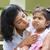 mother comforting upset indian girl stock photo © szefei