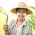 зрелый · фермер · портрет · женщину · лице · трава - Сток-фото © szefei