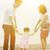 família · caminhada · praia · de · mãos · dadas · sorridente · criança - foto stock © szefei