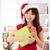 asian christmas woman with gift stock photo © szefei