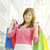 Asian girl holding shopping bags stock photo © szefei