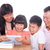parents and children using tablet pc together stock photo © szefei