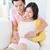 mujer · embarazada · marido · sesión · sofá · tomados · de · las · manos · vientre - foto stock © szefei