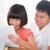 幸せな家族 · デジタル · タブレット · リビングルーム · ホーム · インターネット - ストックフォト © szefei