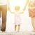 család · sétál · tengerpart · kéz · a · kézben · gyerekek · boldog - stock fotó © szefei