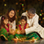 indian family celebrating diwali fesitval of lights stock photo © szefei