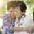 asian elderly women hugging stock photo © szefei