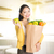 asian woman holding groceries bag in kitchen stock photo © szefei