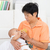 nanny bottle feeding baby stock photo © szefei