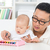 father playing music instrument with baby stock photo © szefei