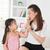 Kid feeding mum ice cream stock photo © szefei