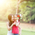 mother and daughter playing windmill in nature park stock photo © szefei