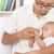 father bottle feeding baby at home stock photo © szefei