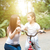 mother and daughter riding bike outdoor stock photo © szefei