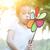 asian child blowing windmill outdoors stock photo © szefei