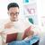 zuidoosten · asian · mannelijke · lezing · boek · genieten - stockfoto © szefei