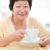 feliz · senior · mulher · café · da · manhã · foco · sessão - foto stock © szefei