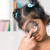 indian girl peers at the camera through a magnifying glass stock photo © szefei