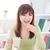 Asia · femenino · comer · cookies · retrato · feliz - foto stock © szefei