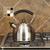 stainless steel tea pot on range stock photo © tab62