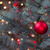 single red ornament hanging from pine tree with glowing lights stock photo © tab62