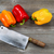 bell peppers and knife on age wood stock photo © tab62