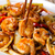 curry shrimp and peppers on white serving plate ready to eat stock photo © tab62