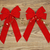 red christmas bows and golden stars on faded wood stock photo © tab62