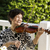 senior woman sitting down while playing her violin outdoors stock photo © tab62