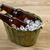 cold beer bottles in metal bucket filled with ice stock photo © tab62
