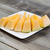 fresh melon slices on white plate with rustic wood underneath stock photo © tab62