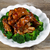 super saucy barbecued ribs with vegetables on white plate stock photo © tab62