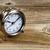 rustic wooden desktop with retro clock stock photo © tab62