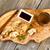 handmade chinese dumplings on fancy wooden server with utensils stock photo © tab62