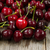 ripe whole black cherries on rustic wood ready to eat stock photo © tab62