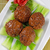 asian meatballs and vegetables with red wine stock photo © tab62