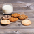 variety of baked cookies on napkin and glass of milk stock photo © tab62