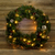 christmas wreath with white lights on rustic wooden boards stock photo © tab62