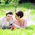 couple · mentir · vers · le · bas · herbe · point - photo stock © taden