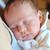 bebek · anneler · silah · kadın · kanepe · gülme - stok fotoğraf © taden
