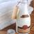 shampoo · fles · roze · handdoek · geïsoleerd · witte - stockfoto © taden