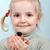 little girl and bullfinch stock photo © taden