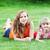 madre · hija · parque · mentir · hierba · primavera - foto stock © taden