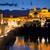 roman bridge and mosque mezquita at evening spain europe stock photo © taiga