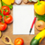 organic vegetables on wooden table and notebook stock photo © taiga