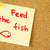 feed the fish remind sticker on cork stock photo © taiga