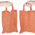 hand holding orange fabric reusable shopping bag stock photo © taigi